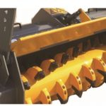 close up of yellow skid steer mulcher