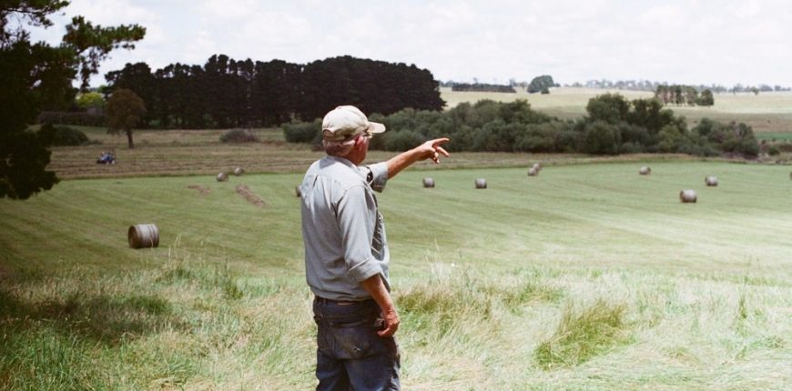 Farmer Overlooking His Pastures | EZ Machinery