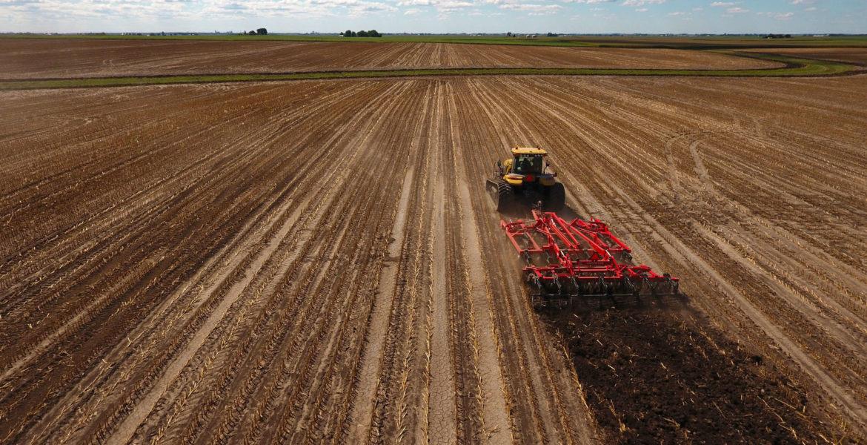 truck plowing a field | EZ Machinery