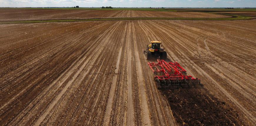 truck plowing a field